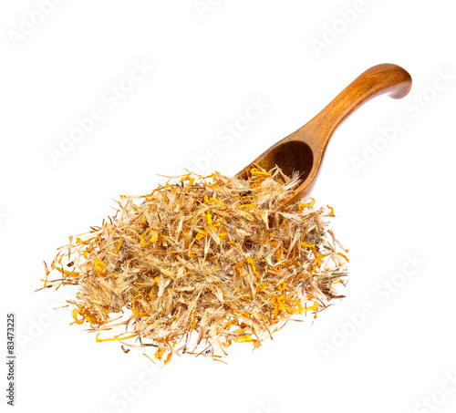Photo Mountain arnica on the wooden spoon.