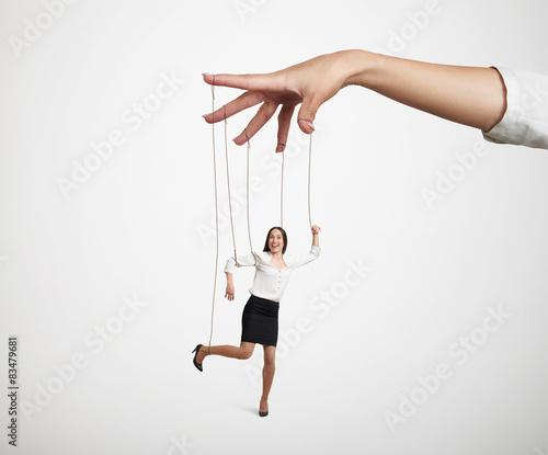 Fototapeta hand manipulating the small puppet