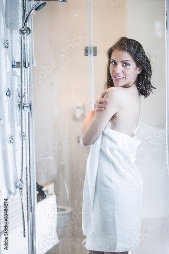 Sexy woman taking a shower