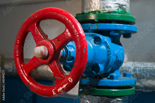 Photo  The red valve on a blue tube