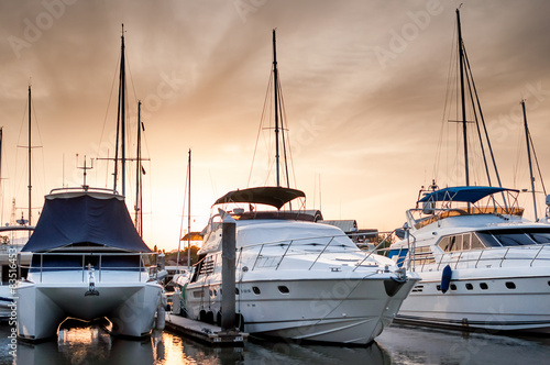 Photo Yacht and boats at the marina in the evening