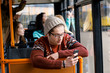 man rides a bus, listening to music