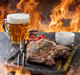 FototapetaBeef steak on wooden table
