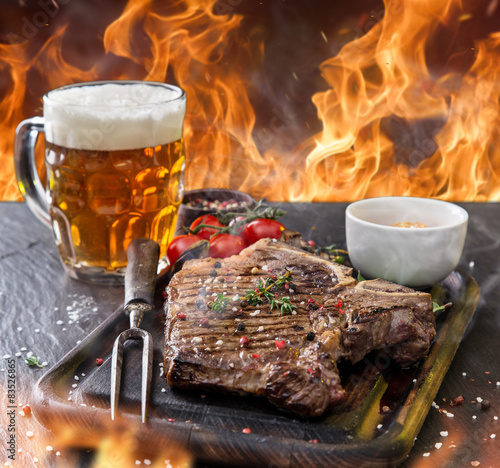 Beef steak on wooden table - 83526865