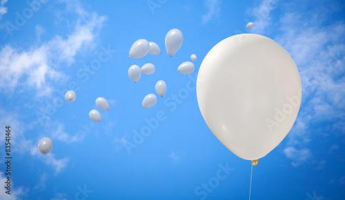 Papiers peints Montgolfière / Dirigeable White Balloons on Sky Background