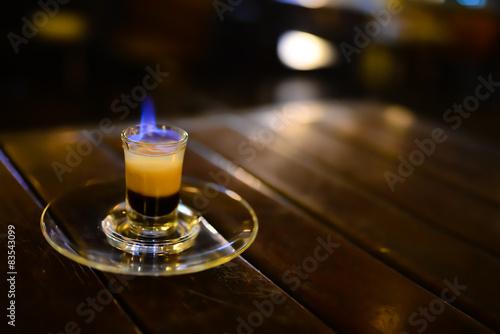 Fotografia  B-52 cocktail with fire