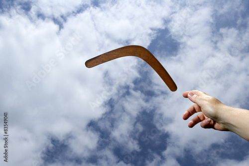 фотография  Throwing plain boomerand, midair