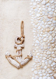 Decorative anchor on the sea sand