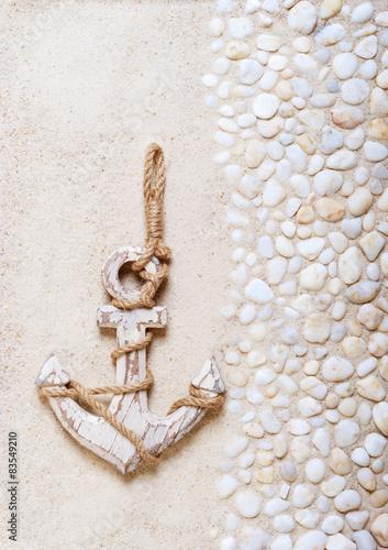 Decorative anchor on the sea sand