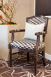 Old fashioned luxurious armchair with squared upholstery