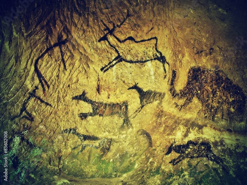 Abstract art in sandstone cave. Black carbon paint of hunting Poster