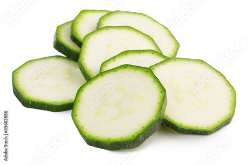 slices of green zucchini isolated on white