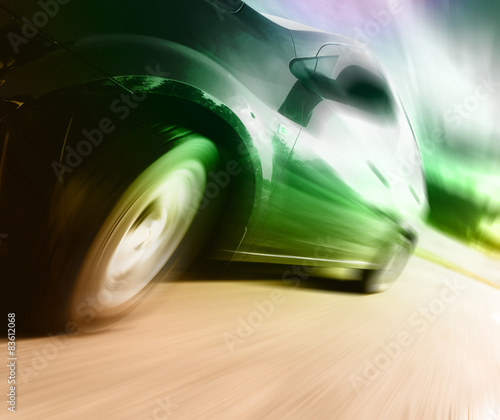 Fototapety, obrazy: Side view of black car in turn