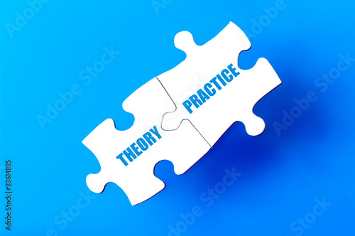 Fotografía  Connected puzzle pieces with words THEORY and PRACTICE