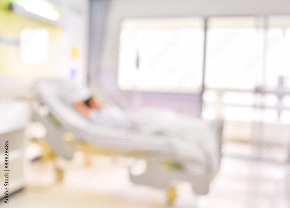 Fototapeta blurred image of Patient with drip in hospital for background us