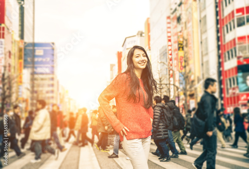 young girl walking on the streets of tokyo Poster