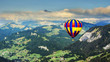 Panoramic view of mountains with a hot air balloon