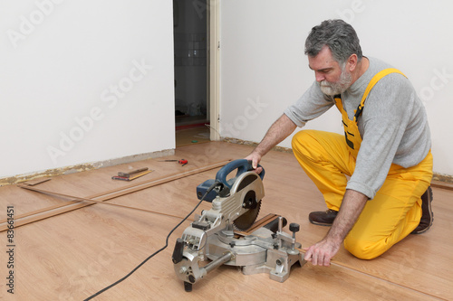 Laminate Flooring Of Room Worker Cut Batten Buy This Stock Photo