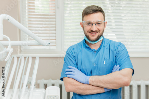 obraz lub plakat Portrait of smiling dentist in the dental office