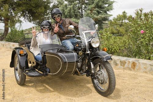 Couple in custom chopper sidecar bike - Buy this stock photo