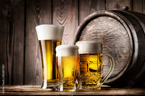Photo  Two glasses and mug of light beer