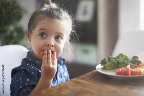 Photo  Eating vegetables by child make them healthier