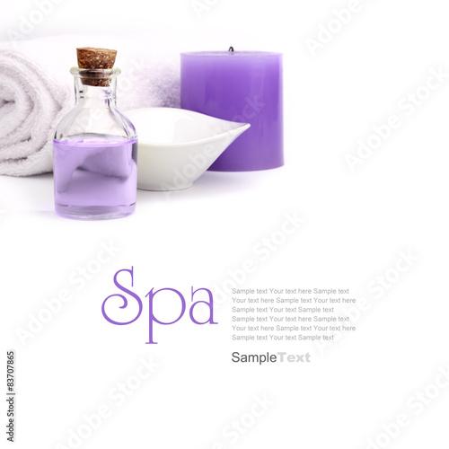 Poster de jardin Spa Spa concept. Purple oil, vessel candle and towel.