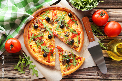 Photo  Fresh tasty pizza on brown wooden background
