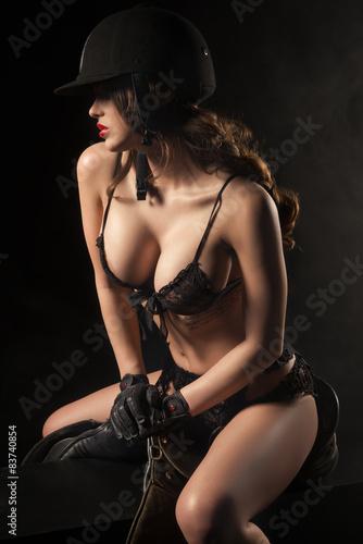 Photo  Sexy woman body with saddle and helmet like jockey