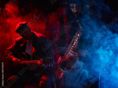 Photo  Beautiful young woman plays saxophone