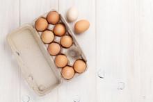 Cardboard Egg Box On Wooden Ta...