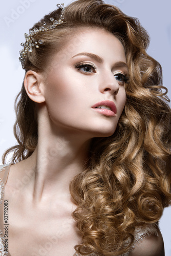 Fototapety, obrazy: Portrait of a beautiful woman in the image of the bride with barrette in her hair. Picture taken in the studio on a grey background