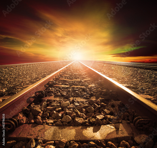 Poster Voies ferrées junction of railways track in trains station agains beautiful li