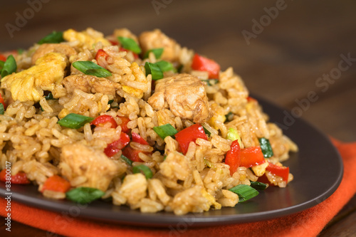 Chinese fried rice with vegetables, chicken and fried eggs