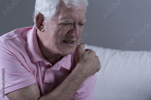 Senior with shoulder pain Canvas Print