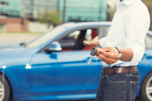 Male Hand Holding Car Keys Offering New Car On Background Buy This
