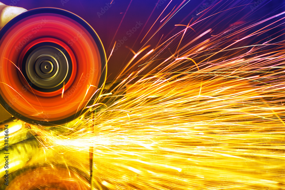 Sparks from circular saw. Metal sawing close up. w salonie