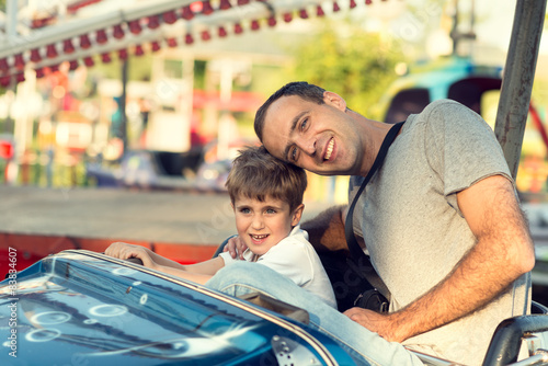Son and father in the amusement park.