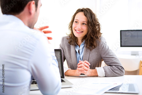 Fotografia  Young attractive woman during job interview