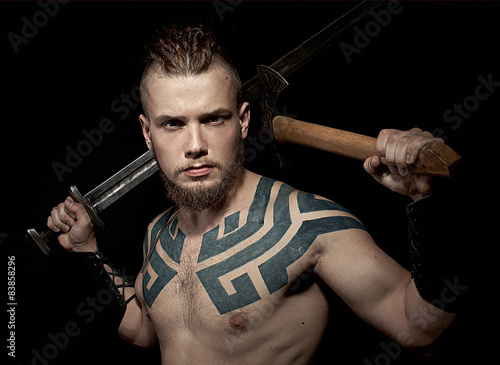 Photo  Viking with sword and axe
