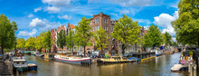 Canal And Bridge In Amsterdam