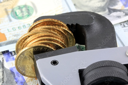 Tighten the Budget Financial Tools US Currency with Wrench
