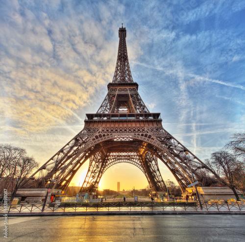 Fotobehang Eiffeltoren Wide shot of Eiffel Tower with dramatic sky, Paris, France