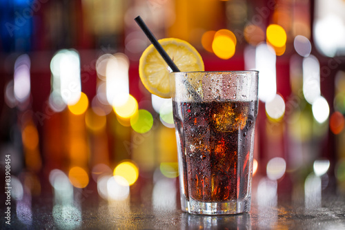 Glass of cola on bar desk Canvas Print