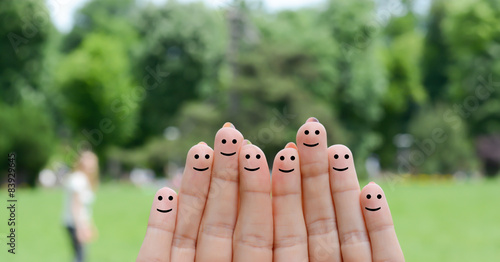 Photo  Happy fingers on green background