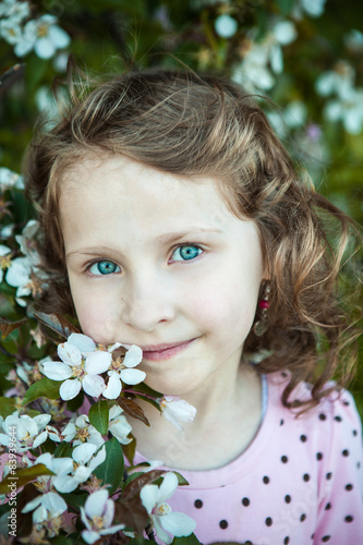 Fotografie, Obraz  beautiful blonde blue-eyed girl in a flowering apple orchard