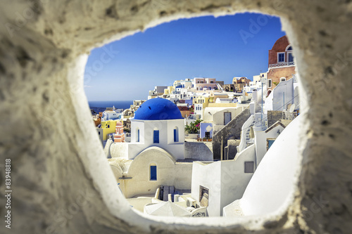 Tuinposter Santorini Santorini blue dome church look through the chimney, Greece