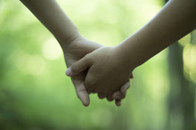 Children Holding Hands In The ...