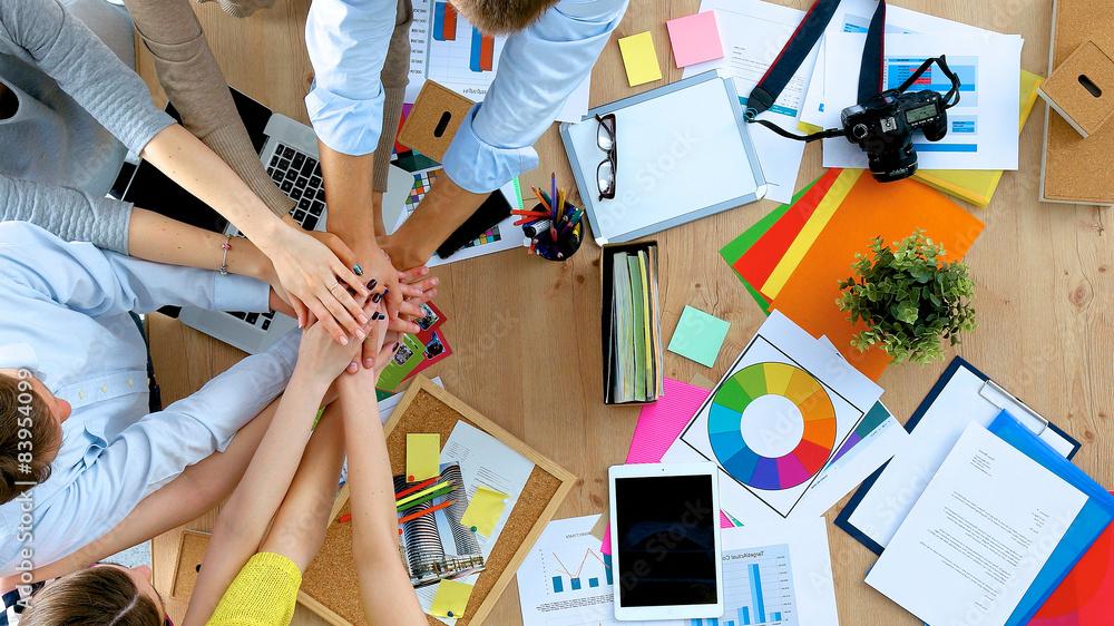 Fototapeta Business team with hands together - teamwork concepts