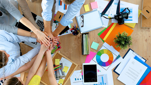 Obraz Business team with hands together - teamwork concepts - fototapety do salonu